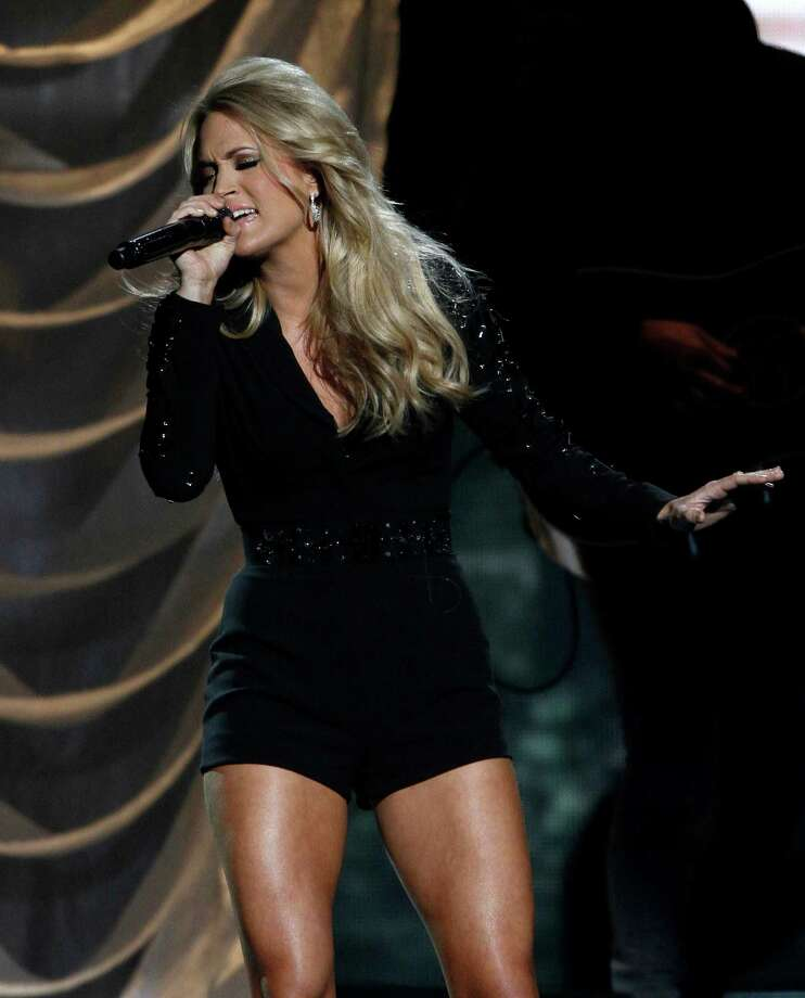 Carrie Underwood performs at the 47th annual CMA Awards at Bridgestone Arena on Wednesday, Nov. 6, 2013, in Nashville, Tenn. (Photo by Wade Payne/Invision/AP) ORG XMIT: TNDC280 Photo: Wade Payne, AP / Invision