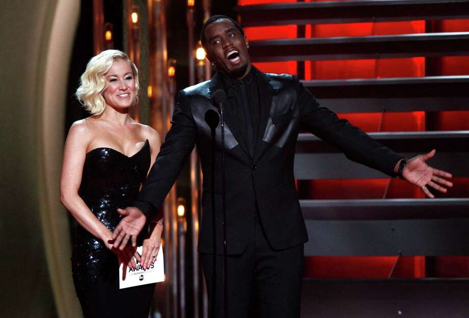 "Kellie Pickler, left, and Sean ""Diddy"" Combs present the award for vocal group of the year at the 47th annual CMA Awards at Bridgestone Arena on Wednesday, Nov. 6, 2013, in Nashville, Tenn. (Photo by Wade Payne/Invision/AP) ORG XMIT: TNDC305 Photo: Wade Payne, AP / Invision"
