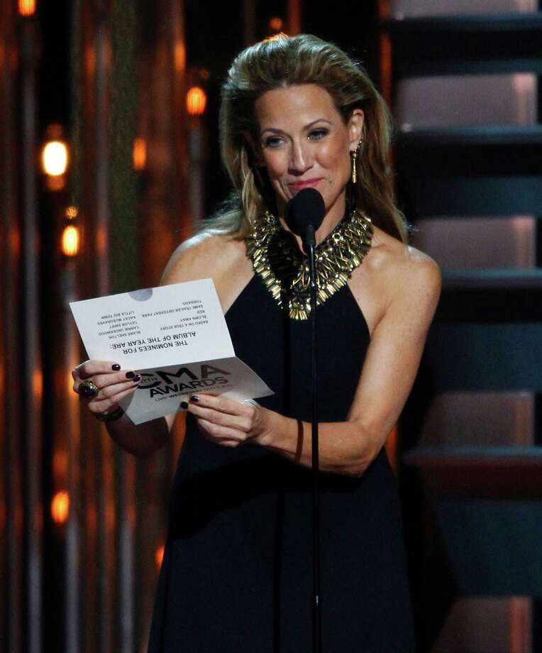 Sheryl Crow presents the award for album of the year at the 47th annual CMA Awards at Bridgestone Arena on Wednesday, Nov. 6, 2013, in Nashville, Tenn. (Photo by Wade Payne/Invision/AP) ORG XMIT: TNDC268 Photo: Wade Payne, AP / Invision