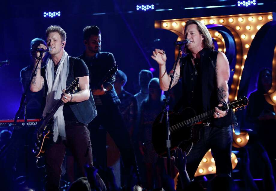 Florida Georgia Line's, Brian Kelley, left, and Tyler Hubbard perform at the 47th annual CMA Awards at Bridgestone Arena on Wednesday, Nov. 6, 2013, in Nashville, Tenn. (Photo by Wade Payne/Invision/AP) ORG XMIT: TNDC251 Photo: Wade Payne, AP / Invision