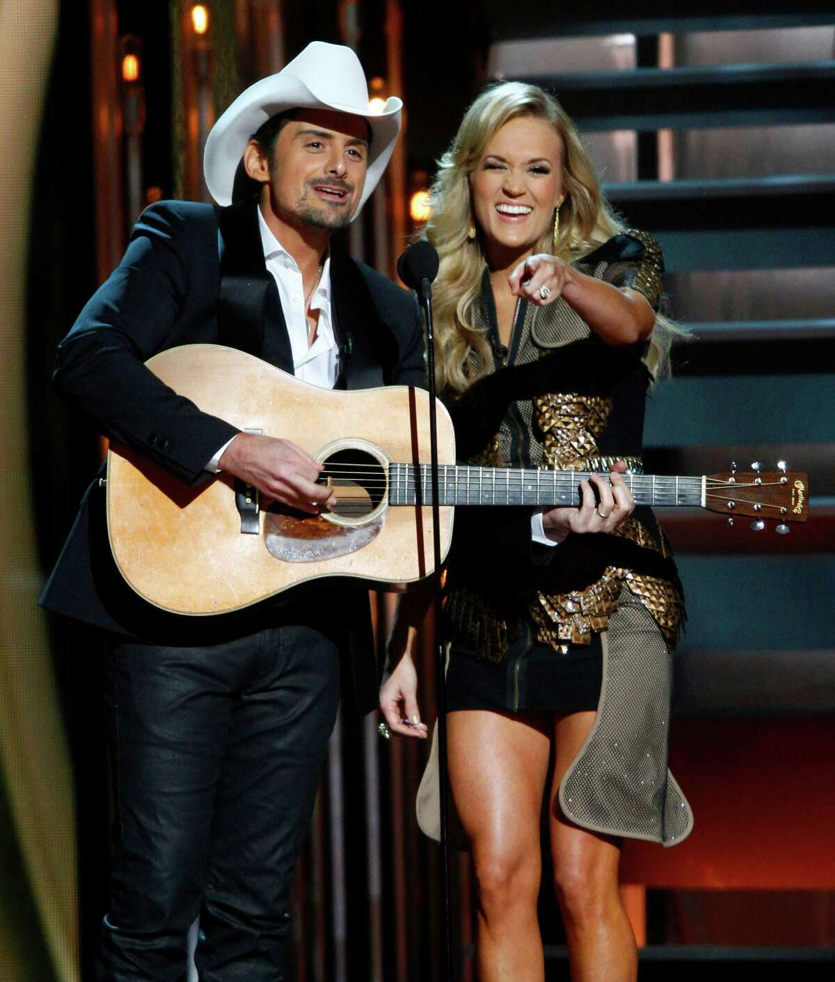 Co-hosts Brad Paisley, left, and Carrie Underwood perform at the 47th annual CMA Awards at Bridgestone Arena on Wednesday, Nov. 6, 2013, in Nashville, Tenn. (Photo by Wade Payne/Invision/AP) ORG XMIT: TNDC213