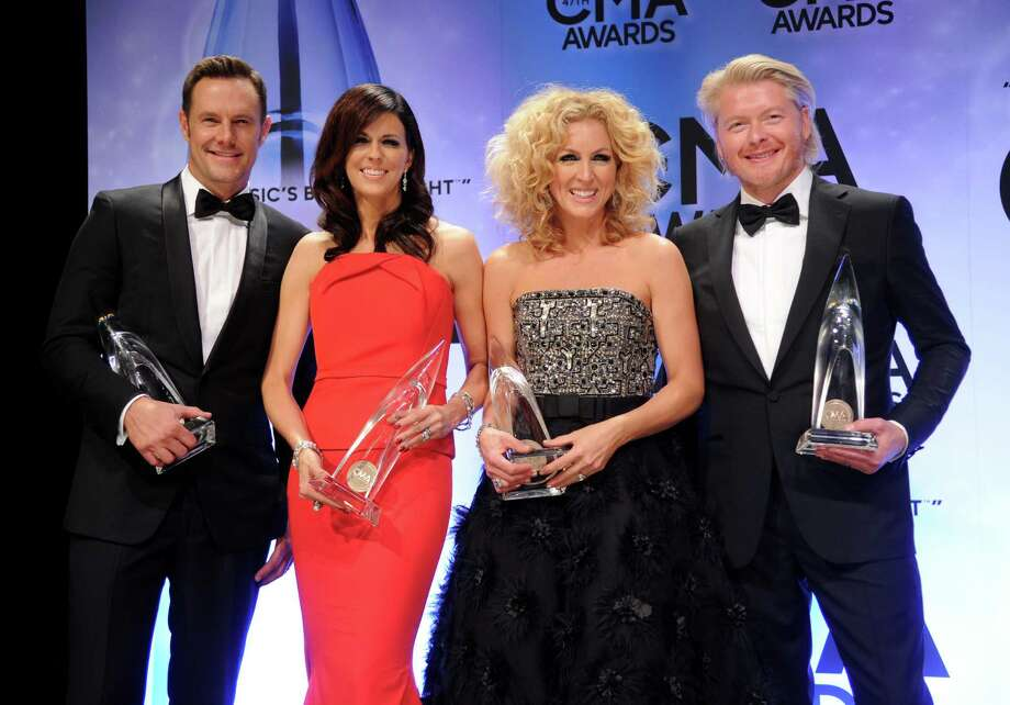 Jimi Westbrook, from left, Karen Fairchild, Kimberly Schlapman and Philip Sweet, of Little Big Town, pose backstage with the award for vocal group of the year at the 47th annual CMA Awards at Bridgestone Arena on Wednesday, Nov. 6, 2013, in Nashville, Tenn. (Photo by Evan Agostini/Invision/AP) ORG XMIT: TNPM128 Photo: Evan Agostini, AP / Invision