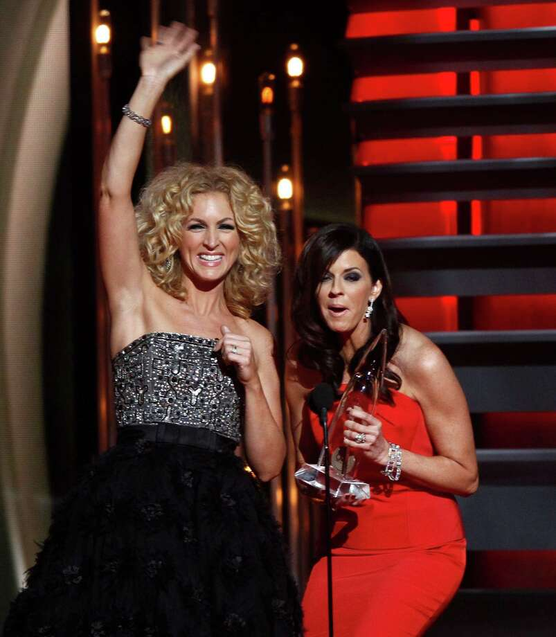 Kimberly Schlapman, left, and Karen Fairchild, of the musical group Little Big Town, accept the award for vocal group of the year at the 47th annual CMA Awards at Bridgestone Arena on Wednesday, Nov. 6, 2013, in Nashville, Tenn. (Photo by Wade Payne/Invision/AP) ORG XMIT: TNDC297 Photo: Wade Payne, AP / Invision