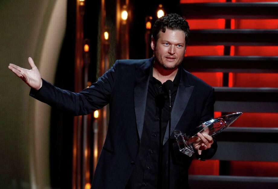 Blake Shelton accepts the award for male vocalist of the year at the 47th annual CMA Awards at Bridgestone Arena on Wednesday, Nov. 6, 2013, in Nashville, Tenn. (Photo by Wade Payne/Invision/AP) ORG XMIT: TNDC310 Photo: Wade Payne, AP / Invision