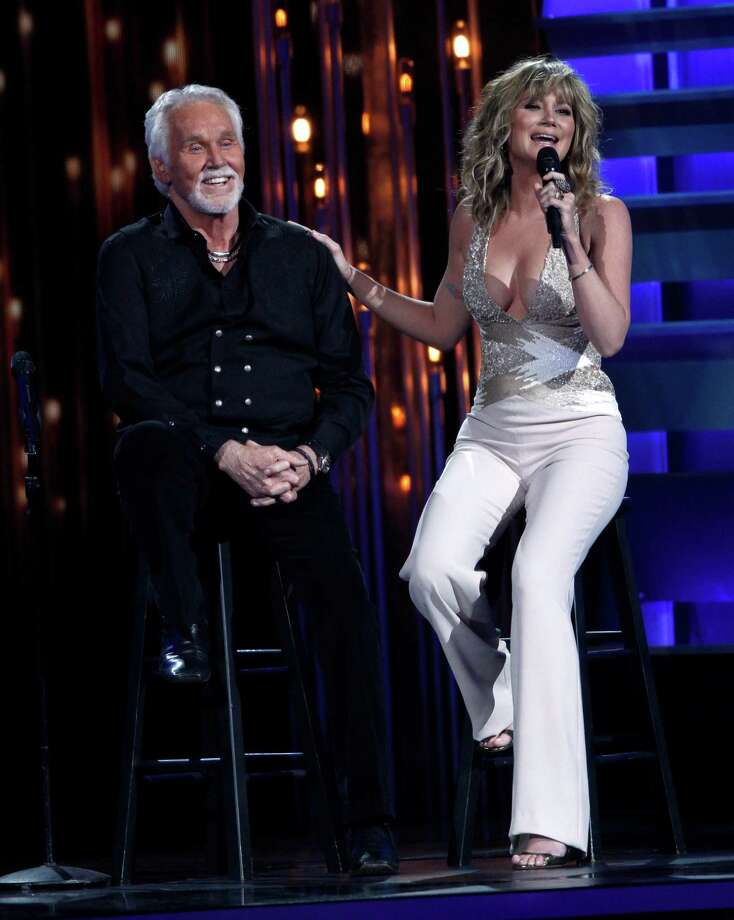 "Jennifer Nettles, right, stands in for Dolly Parton as she and Kenny Rogers sing ""Islands in the Stream"" at the 47th annual CMA Awards at Bridgestone Arena on Wednesday, Nov. 6, 2013, in Nashville, Tenn. (Photo by Wade Payne/Invision/AP) ORG XMIT: TNDC311 Photo: Wade Payne, AP / Invision"