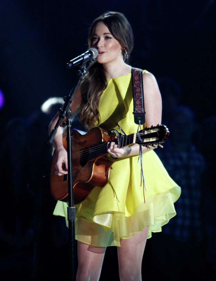 Kacey Musgraves performs at the 47th annual CMA Awards at Bridgestone Arena on Wednesday, Nov. 6, 2013, in Nashville, Tenn. (Photo by Wade Payne/Invision/AP) ORG XMIT: TNDC221 Photo: Wade Payne, AP / Invision