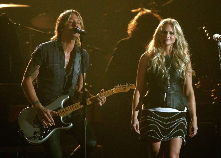 Keith Urban, left, and Miranda Lambert perform at the 47th annual CMA Awards at Bridgestone Arena on Wednesday, Nov. 6, 2013, in Nashville, Tenn. (Photo by Wade Payne/Invision/AP) ORG XMIT: TNDC236 Photo: Wade Payne, AP / Invision