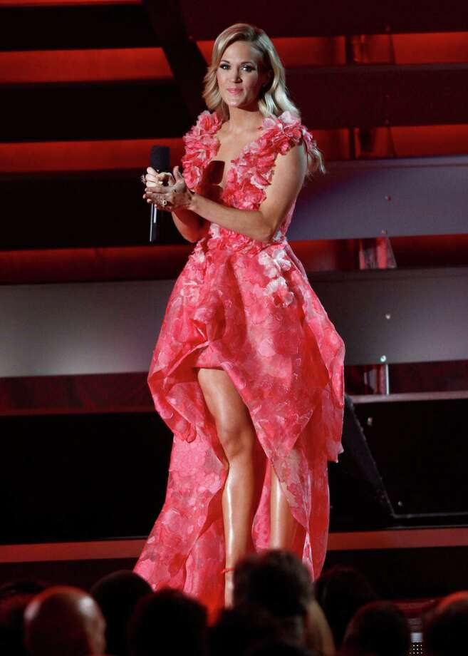 Host Carrie Underwood speaks on stage at the 47th annual CMA Awards at Bridgestone Arena on Wednesday, Nov. 6, 2013, in Nashville, Tenn. (Photo by Wade Payne/Invision/AP) ORG XMIT: TNPM115 Photo: Wade Payne, AP / Invision