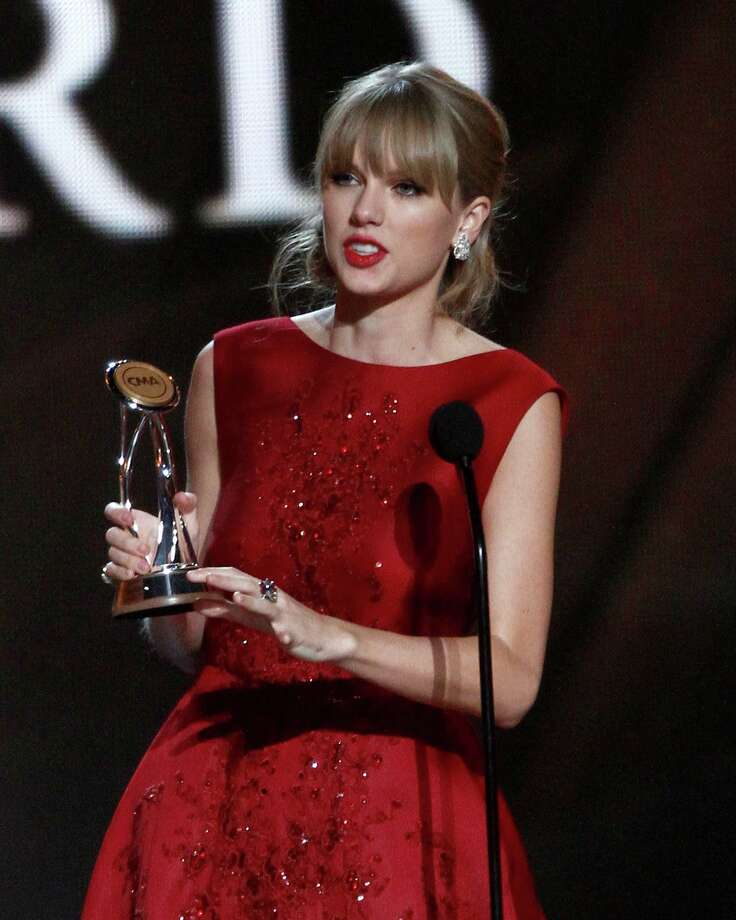 Taylor Swift accepts the Pinnacle award at the 47th annual CMA Awards at Bridgestone Arena on Wednesday, Nov. 6, 2013, in Nashville, Tenn. (Photo by Wade Payne/Invision/AP) ORG XMIT: TNDC272 Photo: Wade Payne, AP / Invision