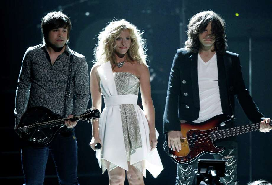 The Band Perry, from left, Neil, Kimberly and Reid Perry perform at the 47th annual CMA Awards at Bridgestone Arena on Wednesday, Nov. 6, 2013, in Nashville, Tenn. (Photo by Wade Payne/Invision/AP) ORG XMIT: TNDC284 Photo: Wade Payne, AP / Invision