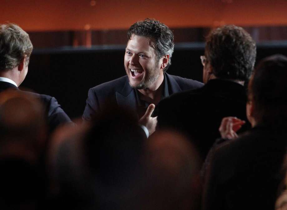 "Blake Shelton reacts as he wins the award for album of the year for ""Based on a True Story ..."" at the 47th annual CMA Awards at Bridgestone Arena on Wednesday, Nov. 6, 2013, in Nashville, Tenn. (Photo by Wade Payne/Invision/AP) ORG XMIT: TNDC270 Photo: Wade Payne, AP / Invision"