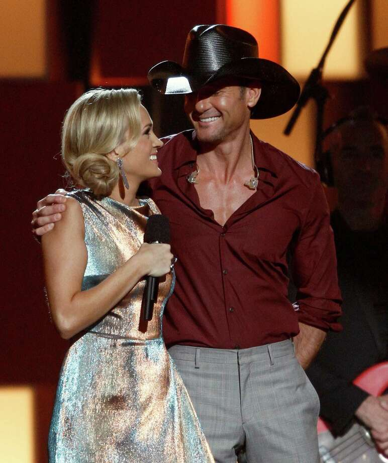 Carrie Underwood, left, and Tim McGraw appear onstage at the 47th annual CMA Awards at Bridgestone Arena on Wednesday, Nov. 6, 2013, in Nashville, Tenn. (Photo by Wade Payne/Invision/AP) ORG XMIT: TNDC342 Photo: Wade Payne, AP / Invision
