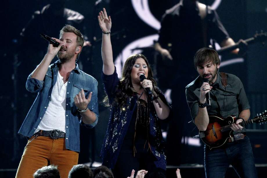 Lady Antbellum, from left, Charles Kelley, Hillary Scott, and Dave Haywood, perform at the 47th annual CMA Awards at Bridgestone Arena on Wednesday, Nov. 6, 2013, in Nashville, Tenn. (Photo by Wade Payne/Invision/AP) ORG XMIT: TNDC226 Photo: Wade Payne, AP / Invision