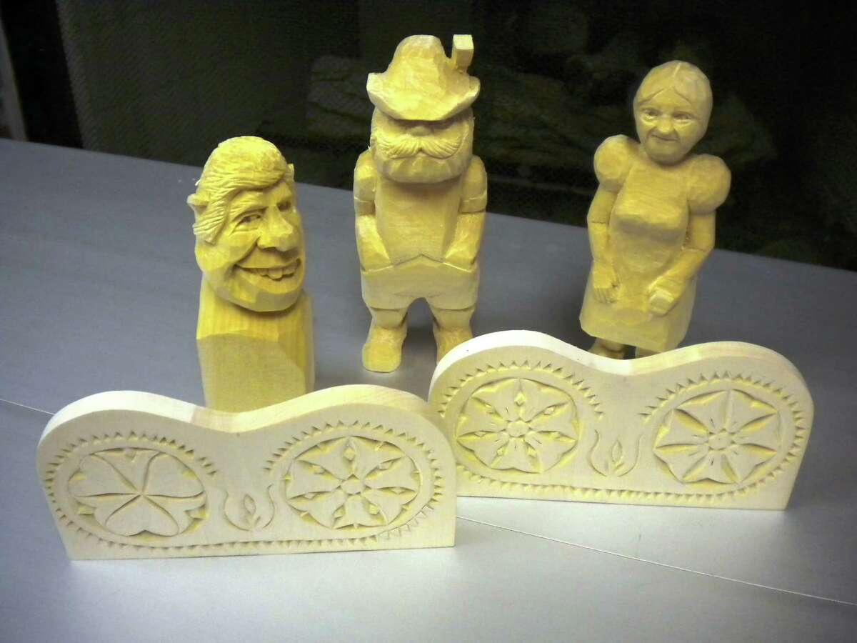 Chip carving and caricatures by JoAn Brueggeman.