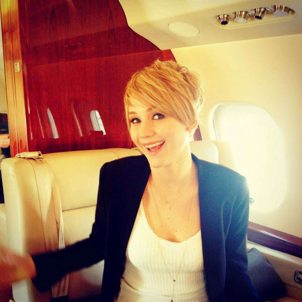"""The """"The Hunger Games: Catching Fire"""" leading lady made the Internet erupt on Wednesday with a photo of her newest 'do, which she revealed on herofficial Facebook fan page."""