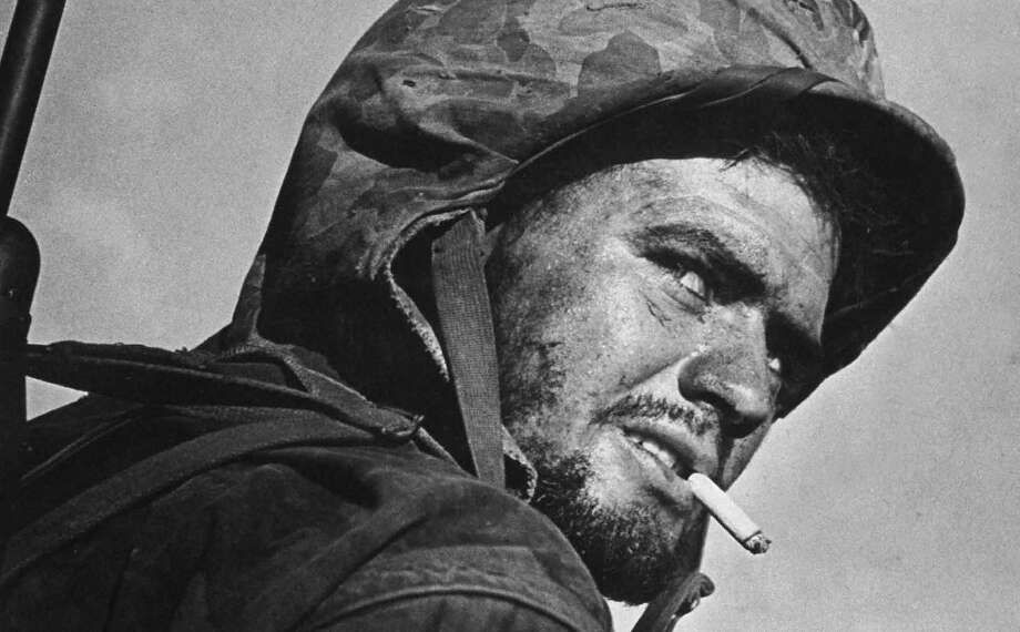 Euaggelos Klonis, a grizzled, battle-weary, cigarette-smoking Marine on Saipan during the fight to wrest the island from Japanese troops, Saipan, Northern Mariana Islands, July 1944. Photo: W. Eugene Smith, Time & Life Pictures/Getty Image / Time Life Pictures