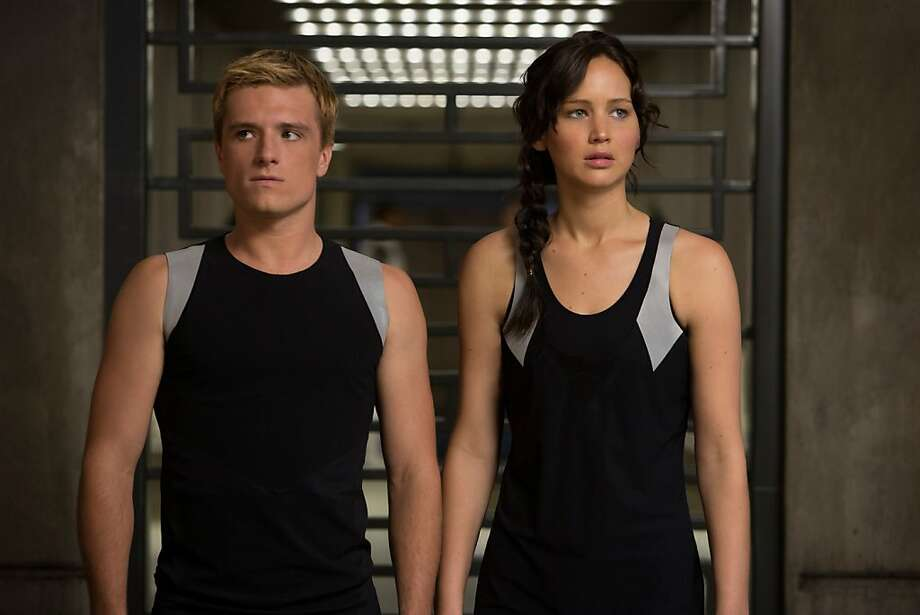 "Peeta (Josh Hutcherson) and Katniss (Jennifer Lawrence) draw the ire of the Capitol in ""Catching Fire."" Photo: Lionsgate"