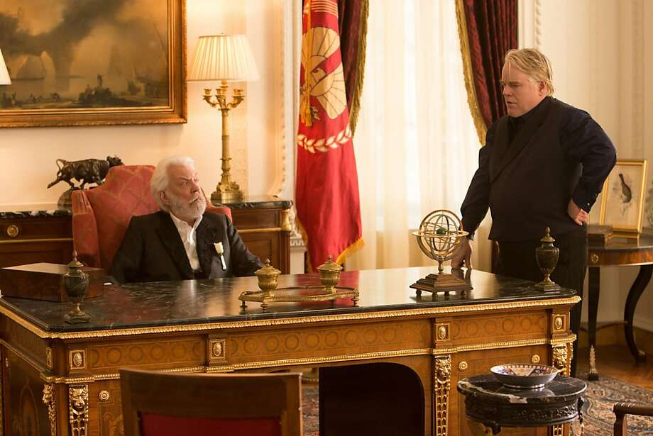 "Donald Sutherland and Philip Seymour Hoffman appear in ""The Hunger Games: Catching Fire."" Hoffman, found dead in his Manhattan apartment on Sunday, Feb. 2, 2014, portrayed ""Plutarch Heavensbee"" in the films. ""The Hunger Games: Mockingjay - Part 2"" is filming now. Photo: Lionsgate"