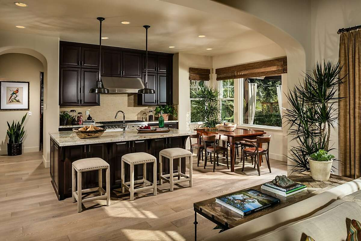 The eat-in kitchen includes a breakfast bar and pendant lighting.