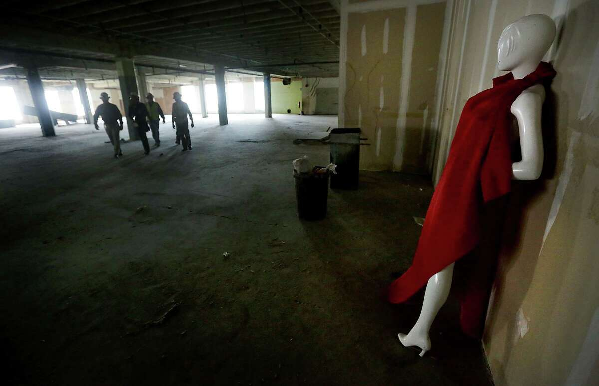 A mannequin draped in red fabric is a reminder of the fashion days at Joske's at the corner of Alamo and Commerce streets.