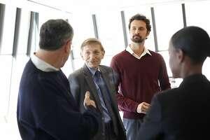 Bill Drayton, the founder of Ashoka, second from left, talks as Michael Zakaras, right, the Director of Ashoka's U.S. Venture Program, and others listen in San Francisco, Calif., on Monday, October 28, 2013.