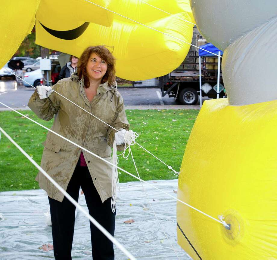 Volunteer Barbara Barclay practices controlling a balloon of Plex from Yo Gabba Gabba during balloon training at Latham Park on Thursday, November 7, 2013, for the USB Parade Spectacular to be held November 24, 2013. Photo: Lindsay Perry / Stamford Advocate
