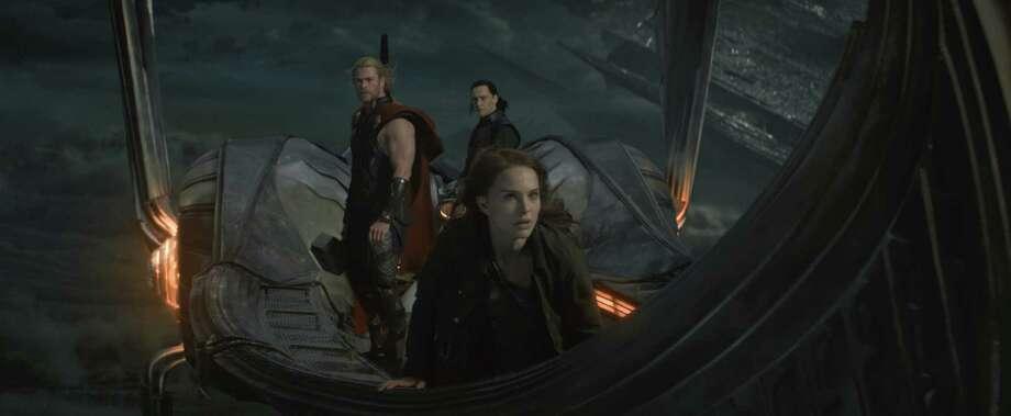 """Marvel's Thor: The Dark World""  L to R: Thor (Chris Hemsworth), Loki (Tom Hiddleston) and Jane Foster (Natalie Portman)  Ph: Film Frame  © 2013 MVLFFLLC. TM & © 2013 Marvel. All Rights Reserved."