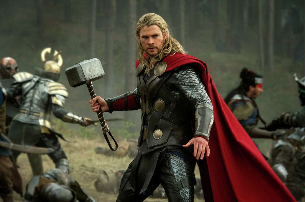 """Thor (Chris Hemsworth) hammers away at the competition in """"Thor: The Dark World."""""""