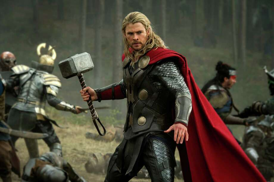 "Thor (Chris Hemsworth) hammers away at the competition in ""Thor: The Dark World."" Photo: Jay Maidment, HOEP / Walt Disney Studios"