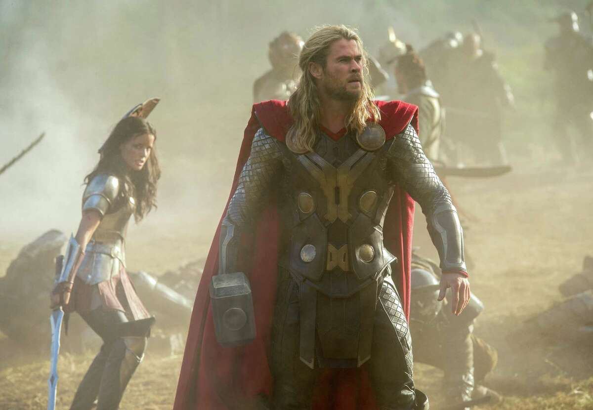 """This publicity photo released by Walt Disney Studios and Marvel shows Jaimie Alexander, left, and Chris Hemsworth in a scene from """"Thor: The Dark World."""" (AP Photo/Walt Disney Studios/Marvel, Jay Maidment)"""