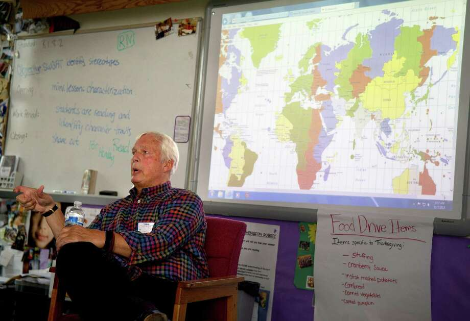 Vietnam veteran Dan Hodges speaks to an eighth-grade class at Turn of River Middle School on Thursday, November 7, 2013, during their Veterans Day Breakfast. Photo: Lindsay Perry / Stamford Advocate