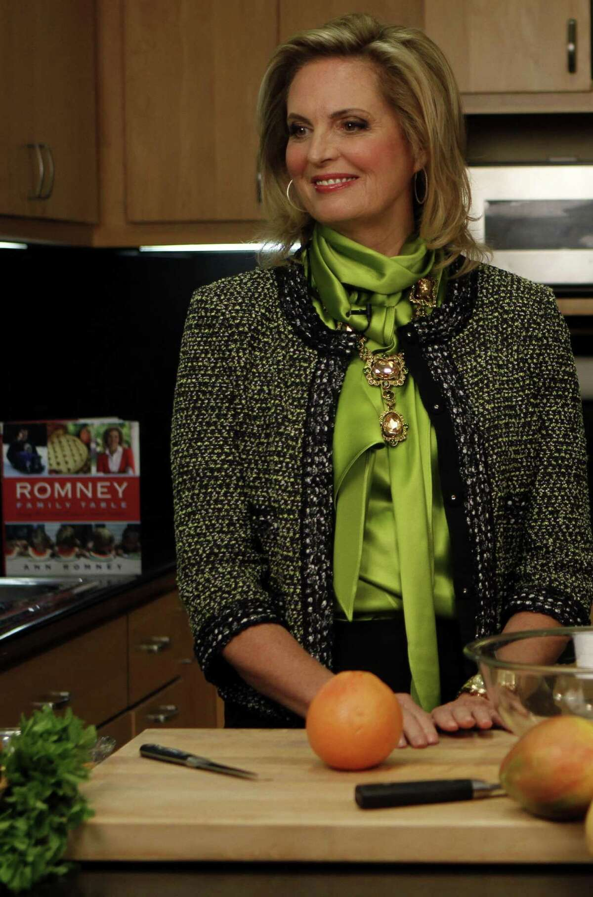 """Ann Romney, left, demonstrates recipes for her citrus salad in the Los Angeles Times' test kitchen in Los Angeles, California, on October 10, 2013. Romney has put out her first cookbook, """"The Romney Family Table."""" (Francine Orr/Los Angeles Times/MCT)"""