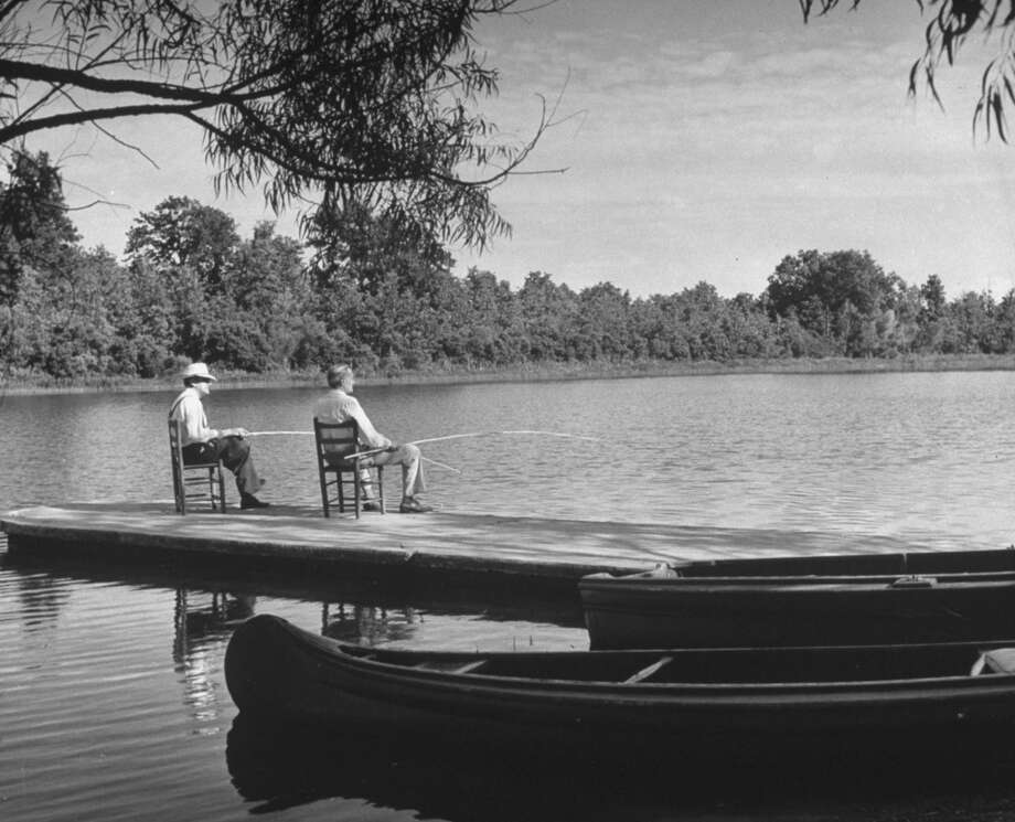 Archie Underwwod (R) cotton man, Marvin Hall (L) state fire insurance commisioner; fishing at Lake Undy near Underwood's home, 1942. Photo: Alfred Eisenstaedt, Time & Life Pictures/Getty Image