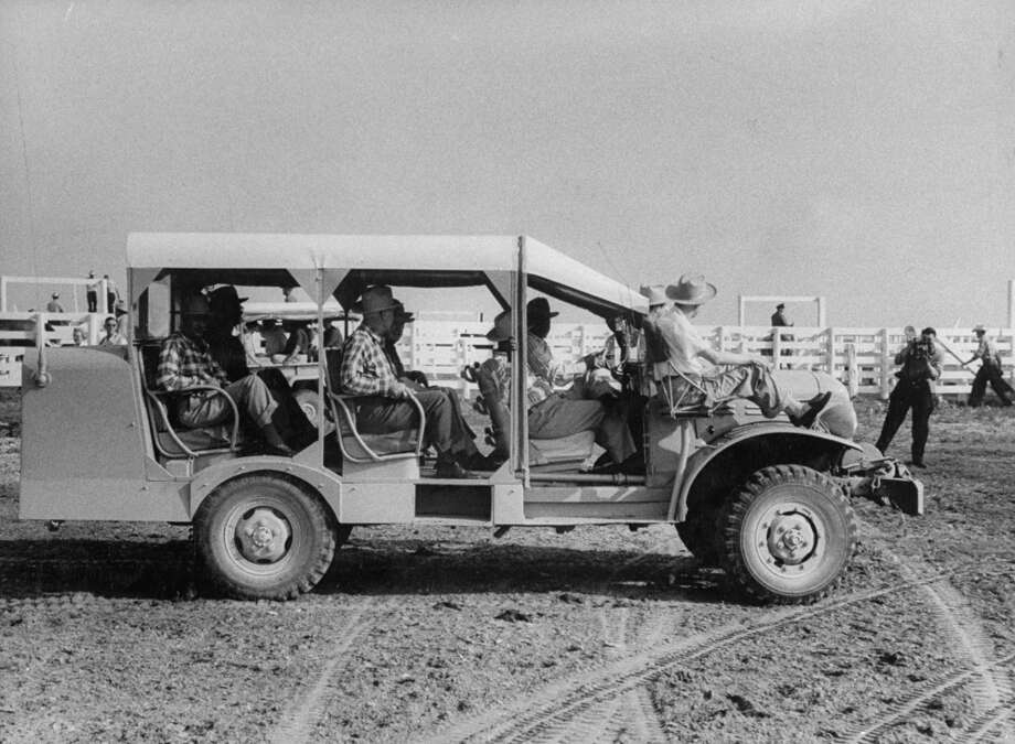 A group of quail hunters riding in a converted truck during a visit on a ranch in 1956. Photo: Joseph Scherschel, Time & Life Pictures/Getty Image