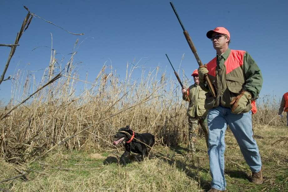 NASCAR Busch series driver and track announcer Wally Dallenbach, hunting dogs, George Privett during the filming his outdoor show at Greystone Castle hunting lodge in Mingus, Texas in 2005. Photo: Sporting News Archive, Sporting News Via Getty Images