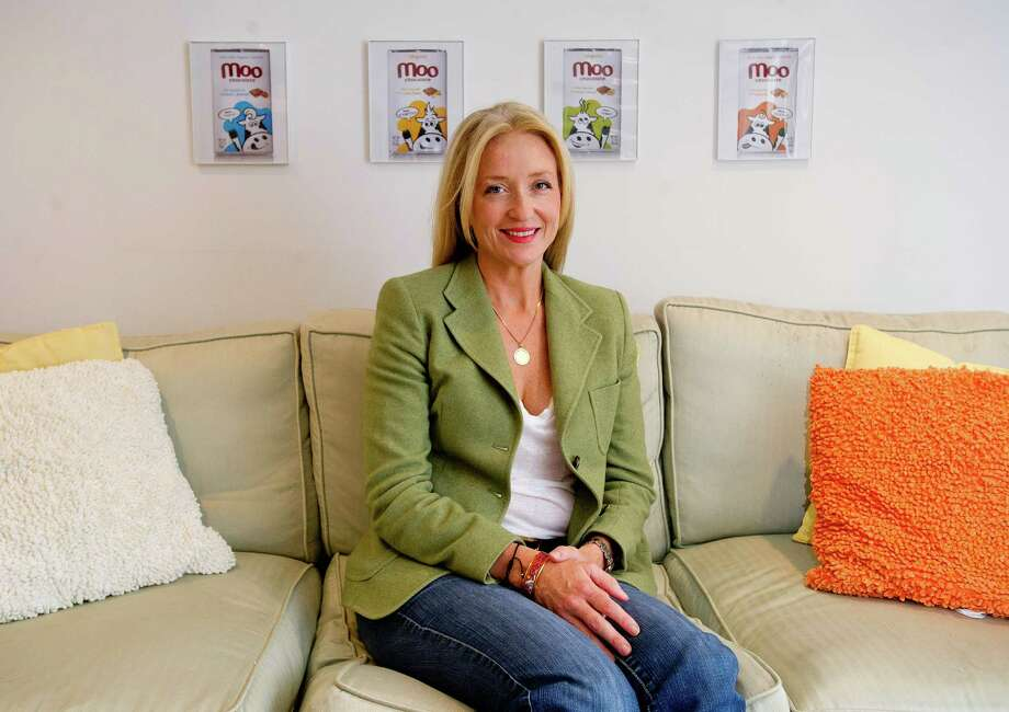 Jackie Ekholm poses for a photo in her Greenwich home office on Thursday, November 7, 2013. Ekholm is the founder of MOO Chocolates. Photo: Lindsay Perry / Stamford Advocate