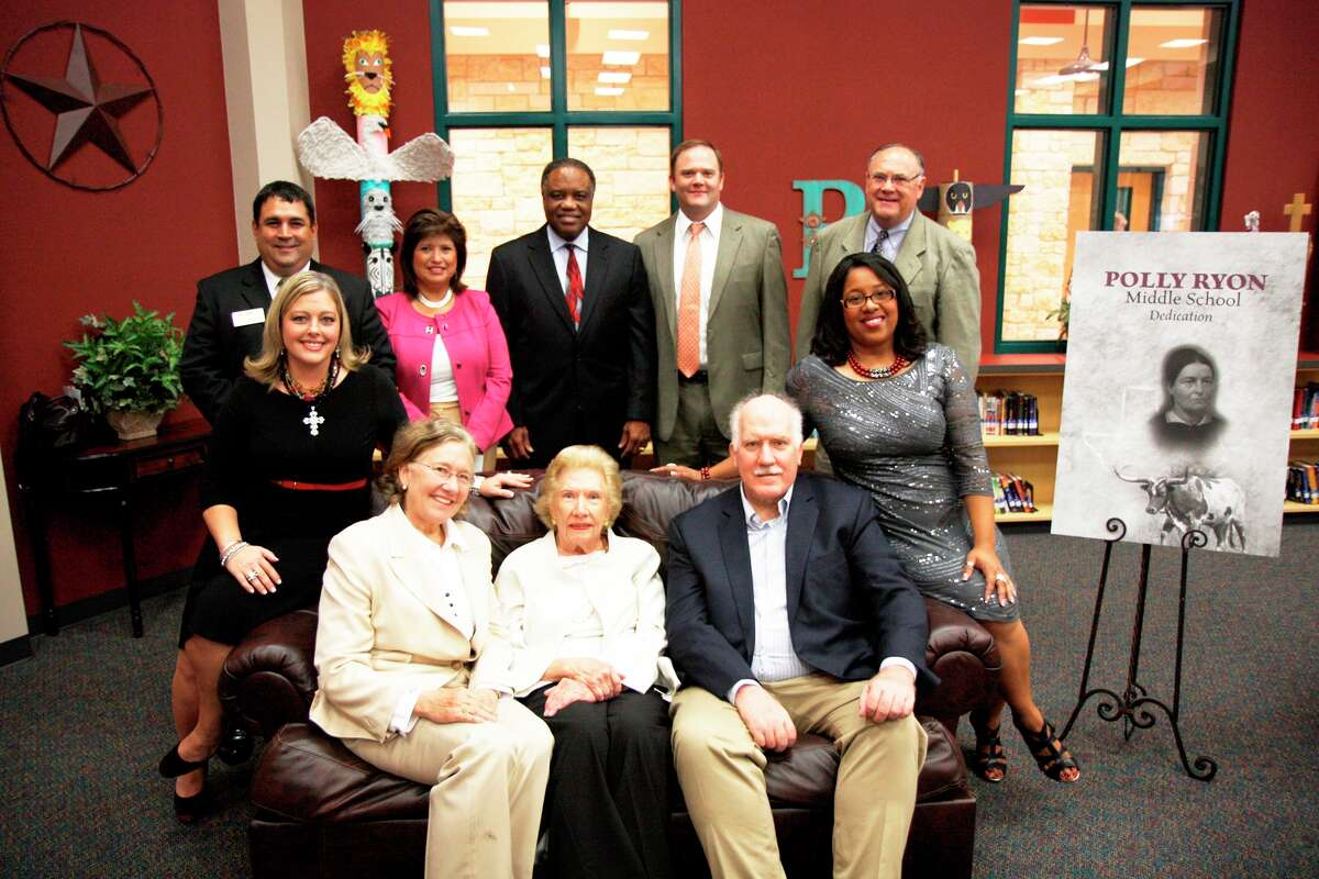 Attending the Nov. 6 dedication of Polly Ryon Middle School, from left, were: back row, Lamar CISD trustees Dar Hakimzadeh and Anna Gonzales; Lamar CISD Superintendent Thomas Randle, George Foundation Chief Executive Officer Roger Adamson, former George Foundation CEO Roland Adamson; leaning on couch, Ryon Middle School Principal Heather Patterson and Assistant Principal Veronica Williams; and front row, Mary Catherine Shouse, Mary Ann Carrico and Earl Shouse.