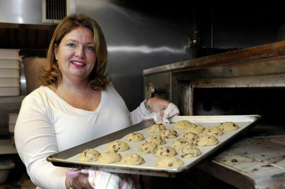 Karli Gray, 47, of Bethel, Conn., with a tray of her Klassic Chocolate Chip cookies, just out of the oven, Wednesday, Nov. 6, 2013. Her business is called Karli's Kookies. Photo: Carol Kaliff / The News-Times