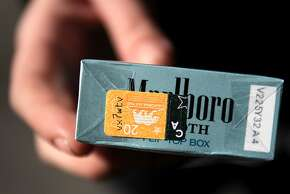 """A """"California Tax Paid"""" stamp can be seen on the bottom of a pack of cigarettes bought by Alexis Bowles, 23, November 7, 2013 in downtown San Francisco, Calif. Those who wish to increase the tax on cigarettes to pay for cancer research are collecting signatures again after a narrow defeat at the ballot box last year."""