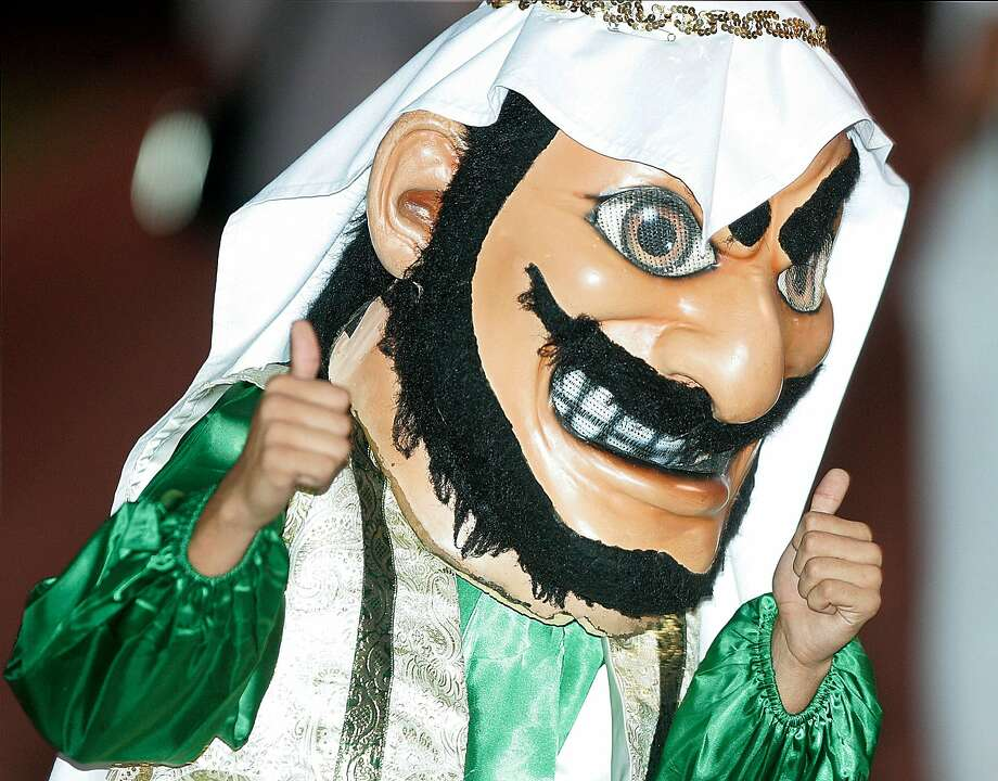 "Coachella Valley High School's mascot, ""Arab,"" gives a thumbs-up at a game. Photo: Jay Calderon, Associated Press"