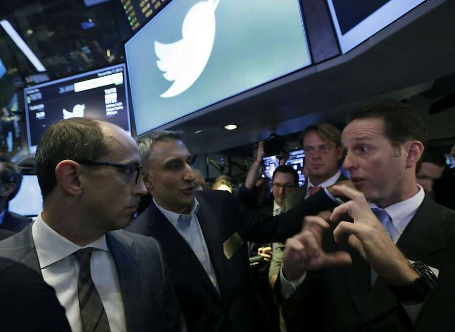 Twitter CEO Dick Costolo (left) and CFO Mike Gupta with Glenn Carell at the New York Stock Exchange. Photo: Richard Drew, Associated Press