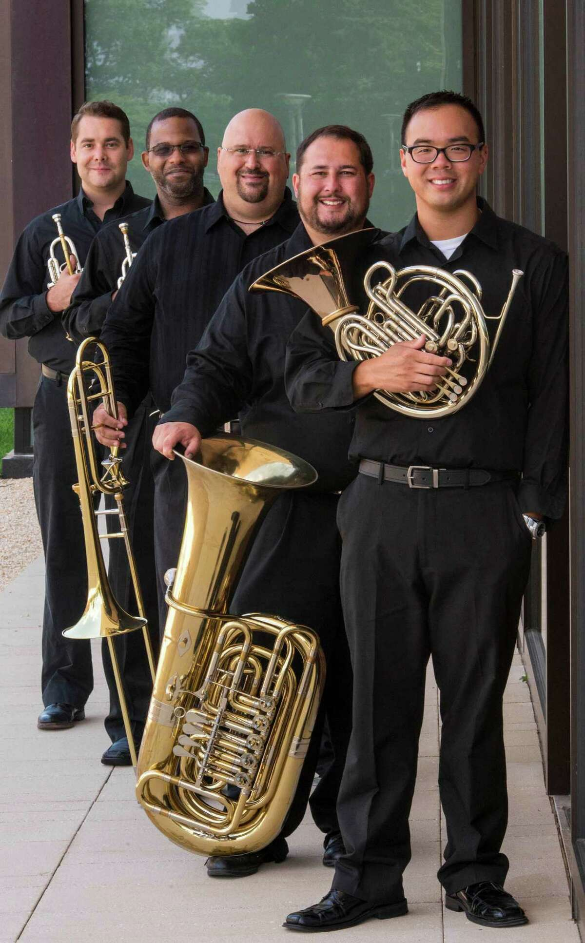 The SHU Faculty Brass Quintet will give it's debut public concert Friday, Nov. 15, 2013 on the Sacred Heart University campus in Fairfield, Conn. From left are Walker Beard, Damon Coachman, Keith Johnston, Jason Bouchard, Kevin Lam.