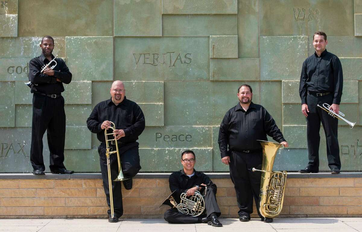 The SHU Faculty Brass Quintet will give it's debut public concert Friday, Nov. 15, 2013 on the Sacred Heart University campus in Fairfield, Conn. From left are Damon E. Coachman, Keith Johnston, Kevin Lam, Jason Bouchard and Walker Beard.