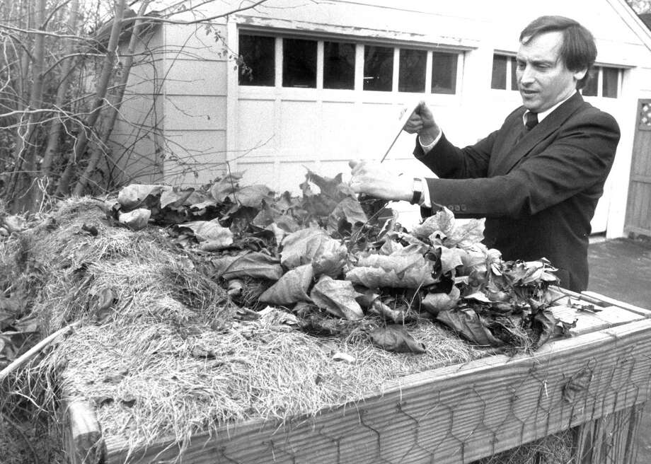 Stamford Mayor Thom Serrani works on the compost bin in his back yard in early November 1988. Photo: File Photo, Advocate / Advocate