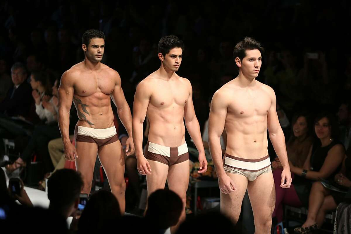 The ladies at right seem to be enjoying themselves:  Designer Yirko Sivirich favors bikini briefs over boxers at the Lima Fashion Week Spring/Summer collections in the Peruvian capital.