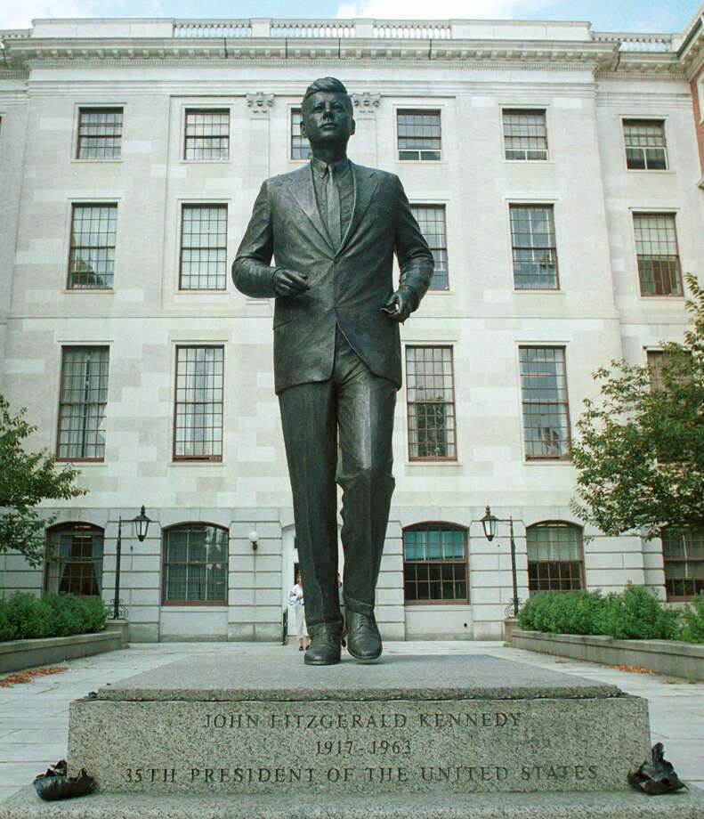 A statue of JFK fronts the grounds of the Massachusetts Statehouse in Boston where Kennedy began his political career. Photo: Associated Press File Photo