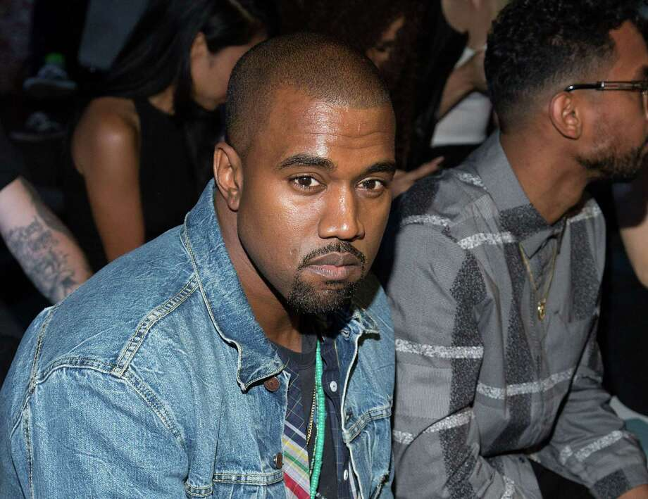 FILE - This Sept. 7, 2012 file photo shows Kanye West at the Alexander Wang collection during Mercedes-Benz Fashion Week in New York. West pleaded not guilty through his attorney to misdemeanor battery and attempted grand theft charges in a Los Angeles court on Thursday Nov. 7, 2013. (Photo by Dario Cantatore/Invision/AP, File) ORG XMIT: NYET401 Photo: Dario Cantatore / Invision