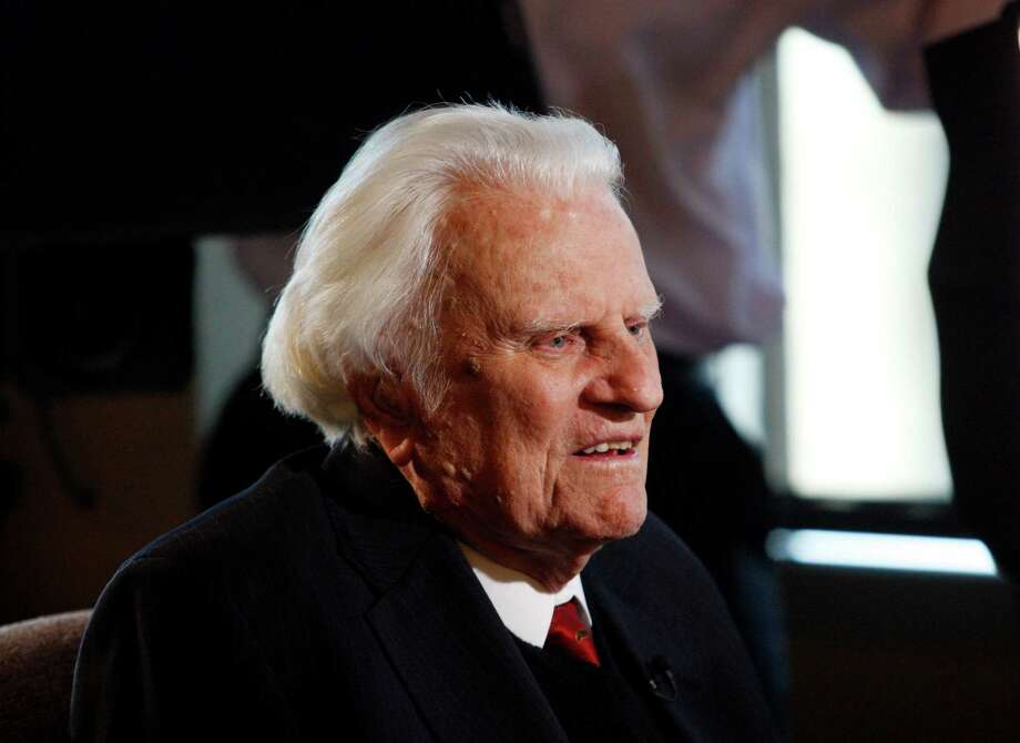 FILE- In this Dec. 20, 2010 file photo, evangelist Billy Graham is interviewed at the Billy Graham Evangelistic Association headquarters in Charlotte, N.C. The evangelist turns 95 on Thursday Nov. 7, 2013 and a big party is planned to celebrate the occasion. Graham's son Franklin has said that as many as 700 people have been invited to the party in Asheville, N.C.  (AP Photo/Nell Redmond, File) ORG XMIT: NY109 Photo: Nell Redmond / FR25171 AP