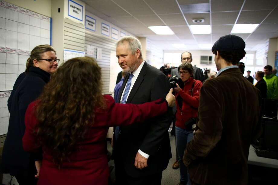 A supporter reaches to hug Seattle Mayor Mike McGinn after he conceded to his competitor Ed Murray at his campaign headquarters in Seattle's International District on Thursday, November 7, 2013. Photo: JOSHUA TRUJILLO, SEATTLEPI.COM