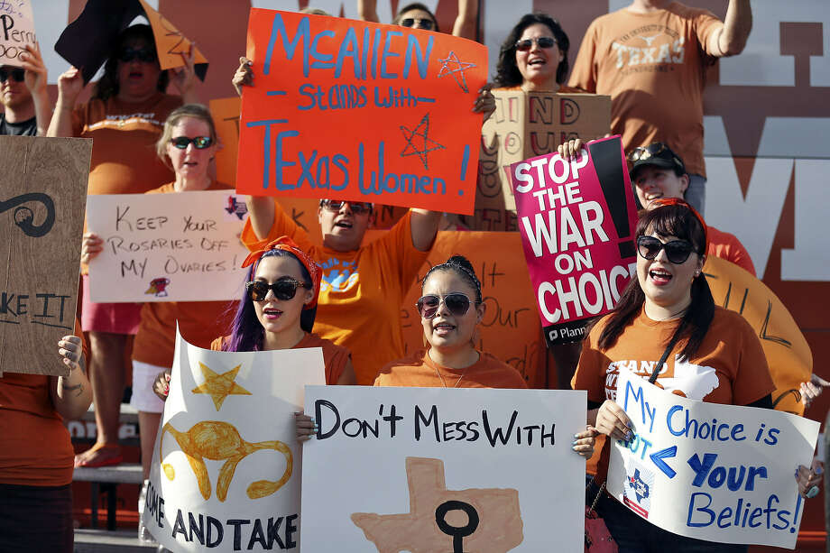Pro-abortion rights supporters chant during a Stand With Texas Women rally at Planned Parenthood in McAllen last summer. A reader asks Texas lawmakers to stop meddling in women's rights. Photo: Edward A. Ornelas / San Antonio Express-News